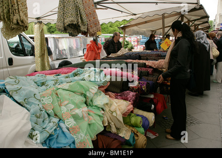 Fabric at the Turkish market at Maybachufer in eastern Kreuzberg, Berlin, Germany - Stock Photo