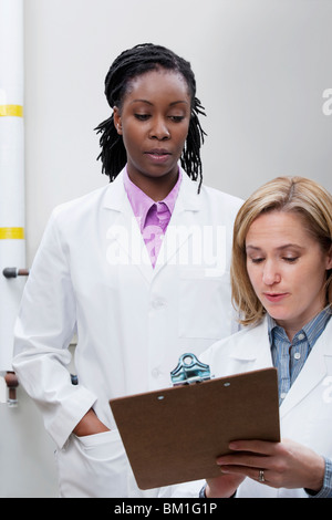 Female doctors working in a laboratory - Stock Photo
