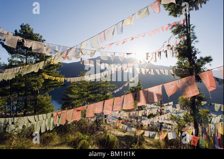 Prayer flags above Thimphu, Bhutan, Asia - Stock Photo