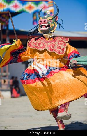 Dancers in costume at Tsechu (festival), Gangtey Gompa (Monastery), Phobjikha Valley, Bhutan, Asia - Stock Photo