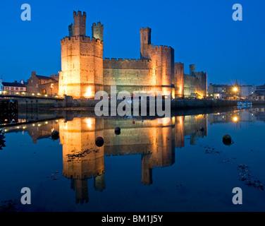 Caernarfon Castle at Night, Caernarfon, Gwynedd, North Wales, UK - Stock Photo