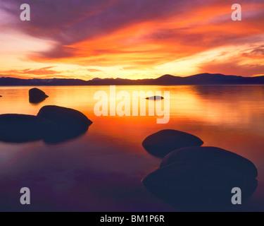 Lake Tahoe Sunset towards Sierra Nevada  Lake Tahoe State Park  Nevada - Stock Photo