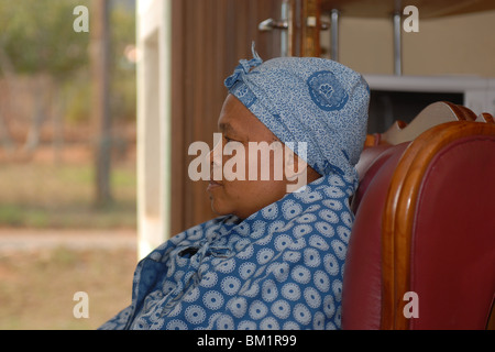 Black lady in a chair - Stock Photo