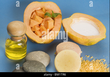 High angle view of papaya with moisturizer and natural soaps - Stock Photo