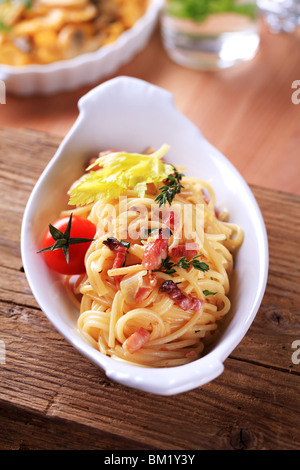 Bowl of spaghetti with bacon, onion and egg - Stock Photo