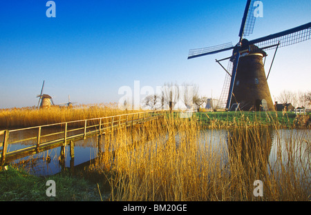 Canal and windmills at Kinderdijk, UNESCO World Heritage Site, Holland, Europe - Stock Photo