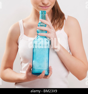 Woman smelling bath crystals - Stock Photo