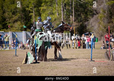 Gainesville FL - Jan 2009 - Two men dressed in armor on horseback sword fighting during jousting demonstration - Stock Photo
