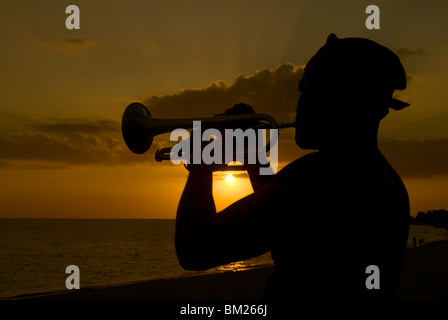 Actor playing the trumpet at sunset, Trinidad, Cuba, West Indies, Central America - Stock Photo