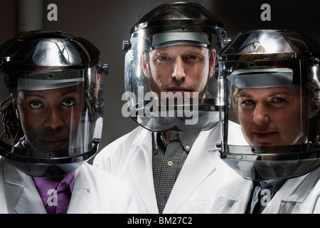 Portrait of doctors wearing protective gear in a laboratory - Stock Photo