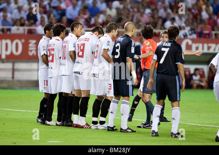 Sevilla FC players forming a wall against a free kick. - Stock Photo
