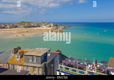 Low tide, looking over the rooftops and across the harbour at St. Ives towards The Island or St. Ives head, Cornwall, - Stock Photo