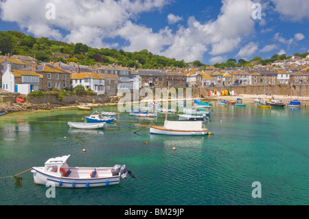 Small fishing boats in the enclosed harbour at Mousehole, Cornwall, UK - Stock Photo