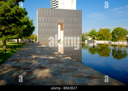 One of the Gates of Time and reflection pool at the Oklahoma City Bombing Memorial in Oklahoma City, Oklahoma, USA. - Stock Photo