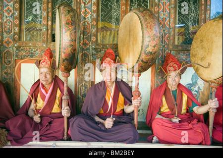 Monks playing drums at a Tsechu (festiva), Gangtey Gompa (Monastery), Phobjikha Valley, Bhutan - Stock Photo