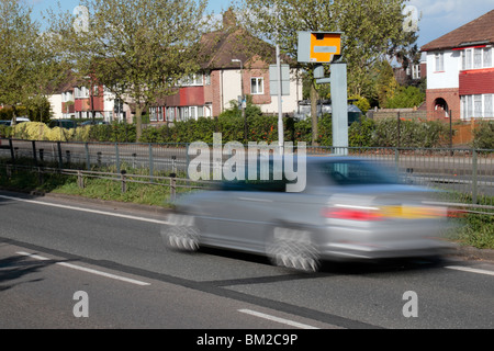 A silver car speeding past a Gatso speed camera on the A316 Great Chertsey Road, Hounslow, UK. SEE DESCRIPTION - Stock Photo