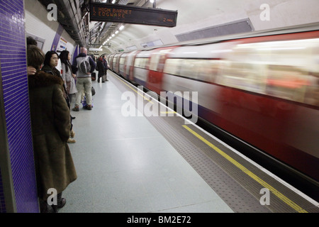 london underground tube commuter train commuters people journey travel travelling commuting station northern line - Stock Photo