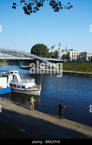 Men fishing in Neris River, Vilnius, Lithuania, Baltic States - Stock Photo