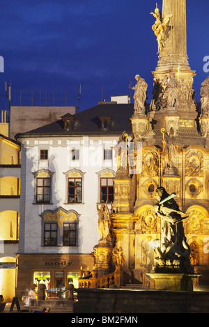 Holy Trinity Column, UNESCO World Heritage Site, in Upper Square (Horni Namesti) at dusk, Olomouc, Moravia, Czech - Stock Photo