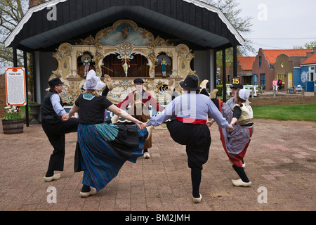 Traditional Dutch dancers performing in front of Amsterdam street organs in Netherlands Village Holland Michigan - Stock Photo