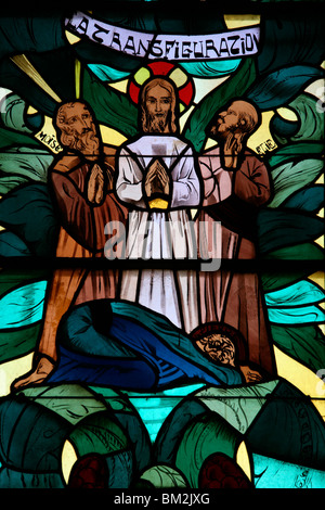 The Transfiguration in the stained glass window of Saint-Joseph des Fins church, Annecy, Haute Savoie, France - Stock Photo
