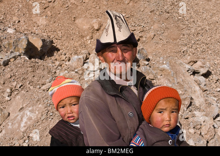 Man with twins in the mountains near Sary Tash, Kyrgyzstan - Stock Photo