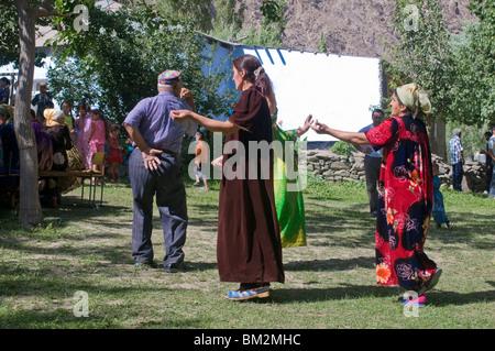 Dancing guests at wedding of Pamiris, Bartang Valley, Tajikistan - Stock Photo