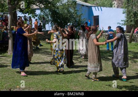 Dancing guests at wedding at Pamiris, Bartang Valley, Tajikistan - Stock Photo