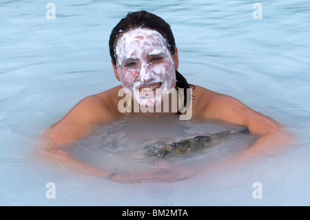 Young woman enjoying bathing in hot spring, Blue Lagoon, Iceland, Polar Regions - Stock Photo