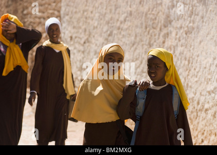Girls stepping out of school in Harar, Ethiopia - Stock Photo