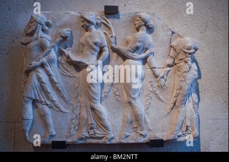 'Relief Votif figurant un Poete Dramatique recevant Dionysos', (Rome) Statue of a Greek God,  in Louvre Museum, - Stock Photo