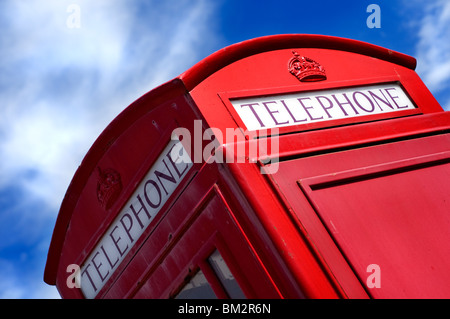An iconic red phone box in England - Stock Photo