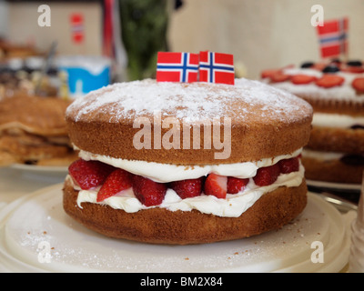 A close up photo of a cake with Norwegian flags made for the celebration of the Norwegian Constitution day on 17th - Stock Photo