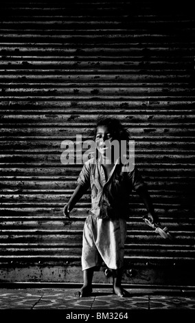 INDIA, MAY 12, 2010: A child laughs in the old town of Ahmedabad, Gujarat, India - Stock Photo