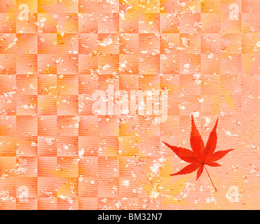 Image of colored maple leaf on pink Japanese paper, full frame - Stock Photo