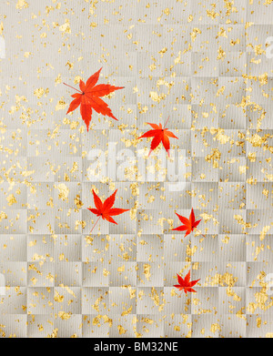 Image of colored maple leaves on silver Japanese paper, full frame - Stock Photo