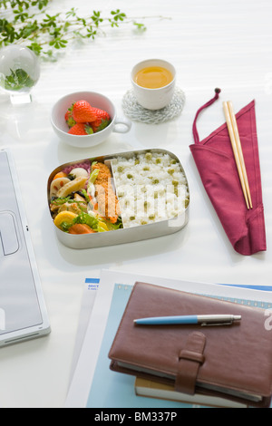 Bento box (Lunch box) on a desk - Stock Photo