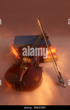 Violin and bow on books