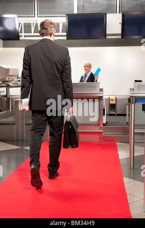 Business man going to airport checkin - Stock Photo