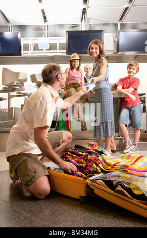 Father handing over travel vouchers - Stock Photo
