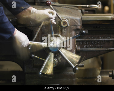 Hands Operating Lever On Machine - Stock Photo