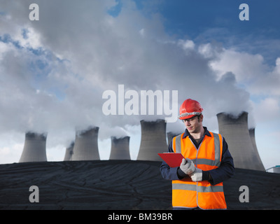 Worker At Coal Fired Power Station - Stock Photo