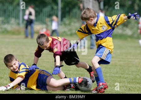 action from the belfast junior gaa schoolboys irish football tournament - Stock Photo