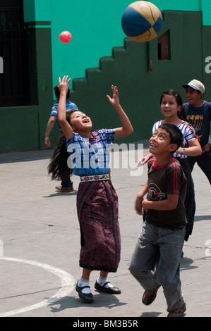 Girl playing basketball, Santiago Atitlan, Lake Atitlan, Guatemala. - Stock Photo
