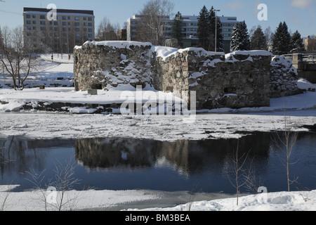 ancient castle snow trees winter snow covered forest frozen park parkland Kajaani Finland city centre - Stock Photo