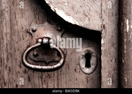 Keyhole and handle on a church door in Scotland - Stock Photo