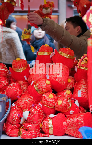A stall selling Chinese New Year decorations for the year ...