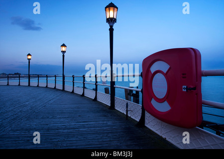 Red life preserver/ring in container on Worthing pier promenade - 15 May 2010 - Stock Photo