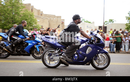 A man rides a motorcycle in a parade in New Haven CT USA - Stock Photo