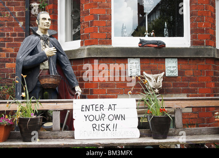 Statue of Dracula outside Gothic themed bed & breakfast in Whitby. Sign says 'enter at your own risk revamp in progress' - Stock Photo